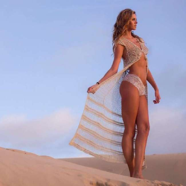 """Эта """"Мисс самые длинные ноги"""" настолько высокая, что заставит вас почувствовать себя хоббитом (14 фото)"""